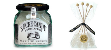 Glass jar of candy sugar and sticks of candy sugar