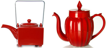 Red teapot and tea cup in glass, porcelain or stoneware. Red empty canister and red tray