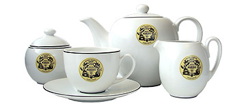 White porcelain tea set with Mariage Frères black and yellow logo